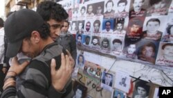 Mourners react during the funeral of relative who was killed in weapons dump attack in Benghazi, Libya, March 5, 2011