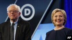FILE - Democratic presidential candidates Bernie Sanders (I-Vt.) and Hillary Clinton appear at a debate in Miami, March 9, 2016.