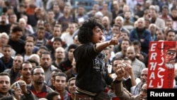 Anti-Morsi protesters chant anti-government slogans at Tahrir Square in Cairo, December 11, 2012.