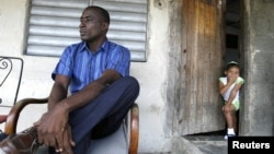 Jorge Luis Garcia Antunez, one of Cuba's longest-serving political prisoners, sits outside his house in Placetas, Cuba.