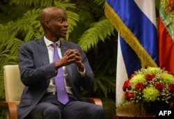 FILE - Haiti's President Jovenel Moise gestures during a meeting with Cuban President Miguel Diaz-Canel (not shown) at Revolution Palace in Havana, Dec. 3, 2018.