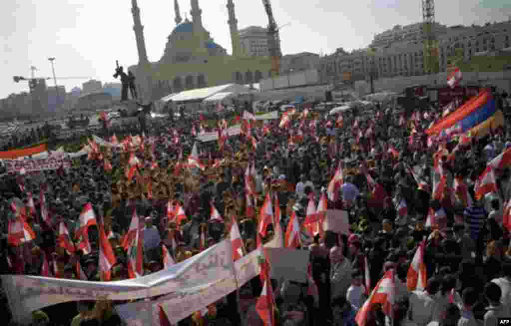 Hundreds of Lebanese of Armenian descent carry Lebanese and Armenian flags as they protest against the visit of Turkish Prime Minister Recep Tayyip Erdogan, in Beirut's Martyrs' Square, Lebanon, Thursday, Nov. 25, 2010. Lebanon has 150,000 Armenians, or n