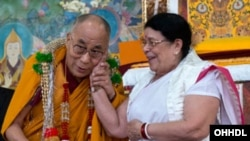 The Dalai Lama with Sumitra Kulkarni (Mahatma Gandhi's granddaughter) during the fifth day of his teachings at Sera Jey Monastery in Bylakuppe, Karnataka, India on December 29, 2013 (photo:dalailama.com)