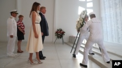U.S. President Donald Trump and first lady Melania Trumplay a wreath at the USS Arizona Memorial in Pearl Harbor, Honolulu, Hawaii, Nov. 3, 2017. Trump begins a five-country trip through Asia traveling to Japan, South Korea, China, Vietnam and the Philippines.