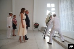 U.S. President Donald Trump and first lady Melania Trump lay a wreath at the USS Arizona Memorial in Pearl Harbor, Honolulu, Hawaii, Nov. 3, 2017. Trump begins a five-country trip through Asia traveling to Japan, South Korea, China, Vietnam and the Philippines.