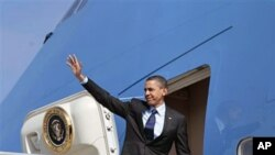 President Barack Obama waves before his departure from Los Angeles International airport in Los Angeles, April 22, 2011