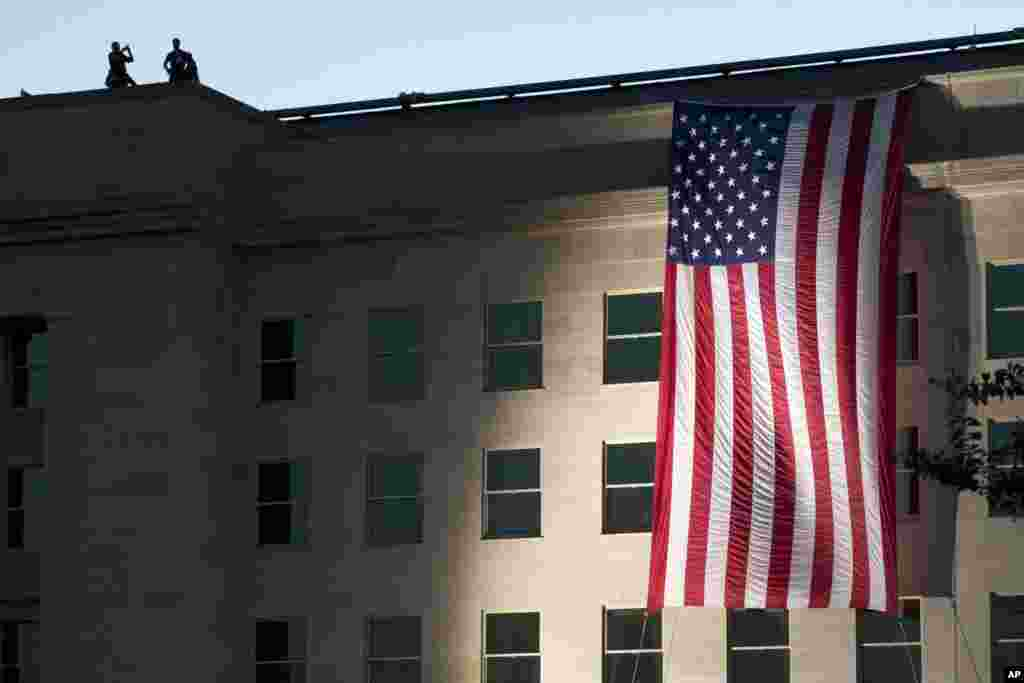 On the 14th anniversary of the attack, a U.S. flag is draped on the side of the Pentagon, Sept. 11, 2015, where the building was attacked on September 11th in 2001.