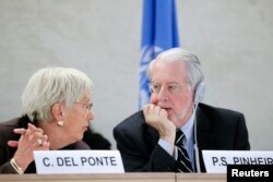 Independent investigators on war crimes in Syria Carla del Ponte and Paulo Pinheiro chat at the U.N. Human Rights Council in Geneva, March 17, 2015.