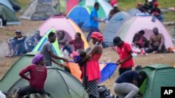 Migrants rest at a camp in Acandi, Colombia, Sept. 14, 2021.