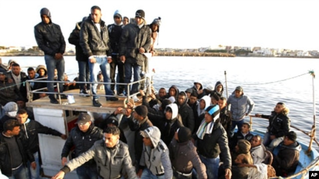 Migrants from North Africa arrive in the southern Italian island of Lampedus, March 7, 2011