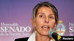 FILE - Judge Sandra Arroyo Salgado, ex-wife of the late prosecutor Alberto Nisman, speaks to a group of senators in Buenos Aires, Feb. 12, 2015.