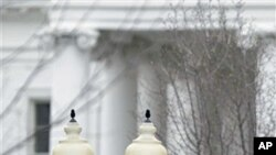 American and Chinese flags fly along Pennsylvania Avenue in front of the White House in Washington, 17 Jan 2011