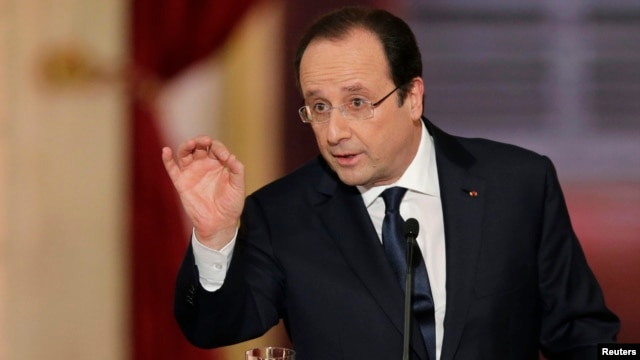 French President Francois Hollande answers a question during a news conference at the Elysee Palace in Paris, Jan. 14, 2014.