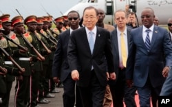 FILE - UN Secretary-General Ban Ki-moon, middle, walks with Burundian First Vice President, Gaston Sindimwso, right, as he arrives in Bujumbura, Burundi, Feb.22, 2016. Ban will return to Burundi to discuss security issues.