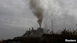FILE - Smoke rises from a coal-fired power plant in Obilic near Pristina, Kosovo, Nov. 1, 2018.