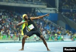 Usain Bolt of Jamaica celebrates winning the gold in the men's 100 meters at the Olympic Games in Rio de Janeiro, Brazil, Aug. 14, 2016.
