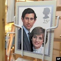 A postcard of a commemorative stamp celebrating the wedding of Prince Charles and Lady Diana Spencer in 1981 is displayed outside a philatelists in London