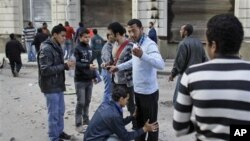 Volunteers check other anti-government protesters to search for and prevent weapons and infiltrators entering the demonstration after brief clashes with pro-government supporters in Talaat Harb square near Tahrir square, Cairo, February 4, 2011