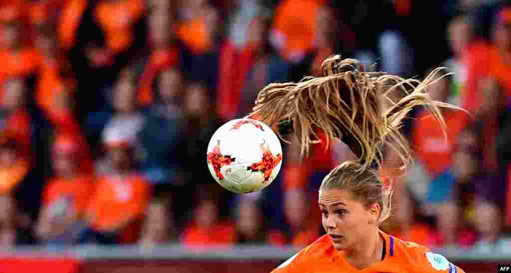 Netherlands' forward Lieke Martens heads the ball during the UEFA Women's Euro 2017 football match between Belgium and the Netherlands at Stadium Koning Wilhelm II in Tilburg, Netherlands, July 24, 2017.