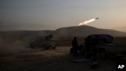 Kurdish Peshmerga soldiers fire artillery at Islamic State positions in Bashiqa, east of Mosul, Iraq, Nov. 7, 2016.