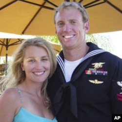 Aaron Vaughn, right, and his wife, Kimberly. Vaughn, a 30-year-old father of two, was among the Navy SEALs killed in Afghanistan.