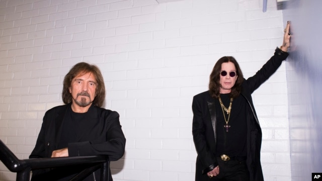 Singer Ozzy Osbourne, right, and musician Geezer Butler of the rock band Black Sabbath pose for a portrait, June 6, 2013 in Los Angeles.