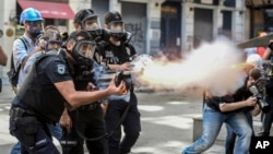 Police fire tear gas as riot police spray water cannon at demonstrators who remained defiant after authorities evicted activists from an Istanbul park, June 16, 2013.