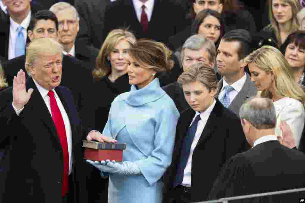 Donald Trump is sworn in as the 45th president of the United States by Chief Justice John Roberts as Melania Trump looks on during the 58th Presidential Inauguration at the U.S. Capitol in Washington, Friday, Jan. 20, 2017. (AP Photo/Andrew Harnik)