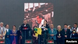 Pro-Kurdish politicians Sirri Sureyya Onder (3rd L) and Pervin Buldan (6th R) read the statement of jailed Kurdish rebel leader Abdullah Ocalan as they are flanked by other Kurdish politicians in the southeastern Turkish city of Diyarbakir, March 21, 2013