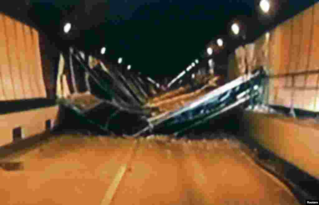 Broken concrete ceiling panels are seen after collapsing inside Sasago Tunnel on the Chuo Expressway in Yamanashi Prefecture, in this handout still image taken from video by Yamanashi Prefectural Police, December 2, 2012.