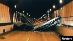 Broken concrete ceiling panels are seen after collapsing inside Sasago Tunnel on the Chuo Expressway, December 2, 2012.
