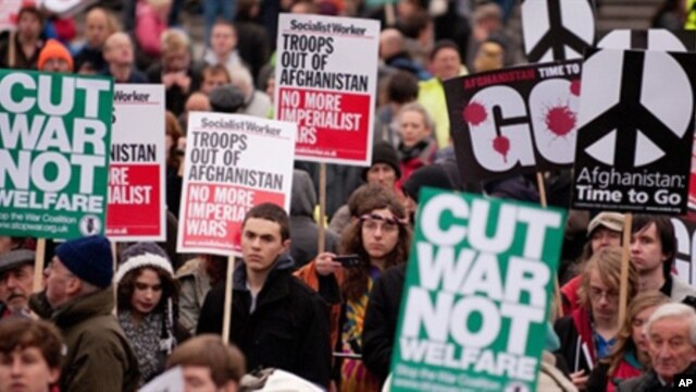 Protestors hold up banners as they gather in Trafalgar Square, central London during a Stop The War demonstration on November 20, 2010 against the continued involvement of Britain in the war in Afghanistan.