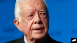 FILE - Former U.S. President Jimmy Carter speaks during a forum in Boston, Aug. 12, 2015.