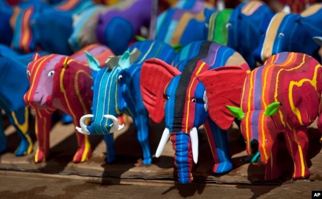 Finished toy animals made from discarded flip-flops are laid out in rows to dry in the sun at the Ocean Sole flip-flop recycling company in Nairobi, Kenya.