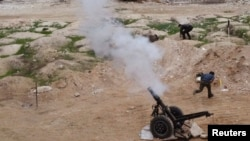 Free Syrian Army fighters launch a weapon towards the forces of Syria's President Bashar al-Assad in Ain Tarma, in Eastern Ghouta, a suburb of Damascus, Jan. 3, 2015.