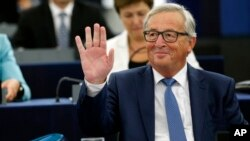 EU Commission President Jean-Claude Juncker waves to the audience prior to deliver his State of the Union address at the European Parliament in Strasbourg, eastern France, Sept. 14, 2016.