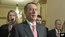 Speaker of the House John Boehner returns to his office after emergency legislation to avert a government default and cut federal spending passed a vote in the House of Representatives, Aug. 1, 2011
