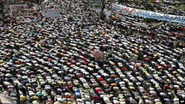 "Protesters conduct Friday Prayers in Tahrir square in Cairo. Thousands of Egyptians converged on Cairo's Tahrir square on Friday in what organizers called a ""second revolution"" to push for deeper reforms and a speedy trial for ousted President Hosni Mubar"