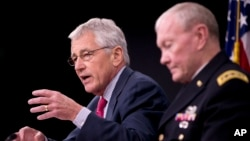 U.S. Defense Secretary Chuck Hagel, left, and Joint Chiefs Chairman Gen. Martin Dempsey brief reporters at the Pentagon, July 3, 2014.