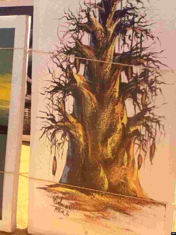 No quadro uma pintura de um dos símbolos de Angola, o imbondeiro. Angola, Luanda, Praça do Artesanato do Benfica.Maio 29, 2014