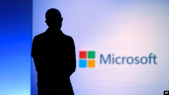 In this May 7, 2018, file photo Microsoft CEO Satya Nadella looks on during a video as he delivers the keynote address at Build, the company's annual conference for software developers in Seattle. (AP Photo/Elaine Thompson, File)