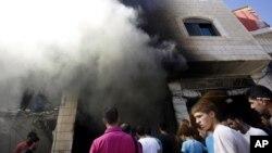 Escena del ataque israelí contra dos palestinos sospechosos de secuestrar a tres adolescentes israelíes.
