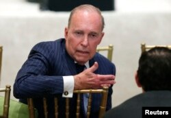 Larry Kudlow, director of the National Economic Council, speaks with another attendee as U.S. President Donald Trump hosts a joint press conference with Japan's Prime Minister Shinzo Abe at Trump's Mar-a-Lago estate in Palm Beach, Florida, April 18, 2018.