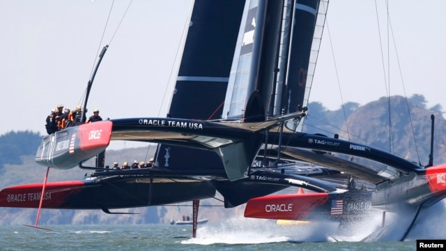 Oracle Team USA's AC72 catamarans train near Golden Gate Bridge, San Francisco Bay, California, Aug. 21, 2013.