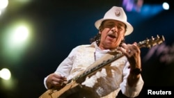FILE - Mexican guitarist Carlos Santana performs onstage during the 45th Montreux Jazz Festival in Montreux July 2, 2011.