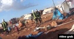 ຮູບພາບຈາກ ວີດີໂອ ຂອງກຸ່ມ White Helmet' ທີ່ປົກປ້ອງພົນ ລະເຮືອນຊີເຣຍ ສະແດງໃຫ້ເຫັນ ຫລັງຈາກການໂຈມຕີ.