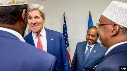 US Secretary of State John Kerry (2ndL) meets with Somalia's President Hassan Sheikh Mohammed (2ndR) and Somali regional leaders at the airport in Mogadishu on May 5, 2015.