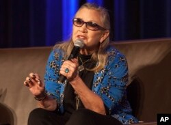 FILE - Carrie Fisher speaks during Wizard World Chicago Comic-Con at the Donald E. Stephens Convention Center in Chicago, Aug. 21, 2016.