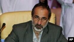 Cleric Ahmad Maath al-Khatib was chosen in Doha voting to lead newly united opposition to oust Syrian's president, Bashar al-Assad, Nov. 11, 2012. (AP)