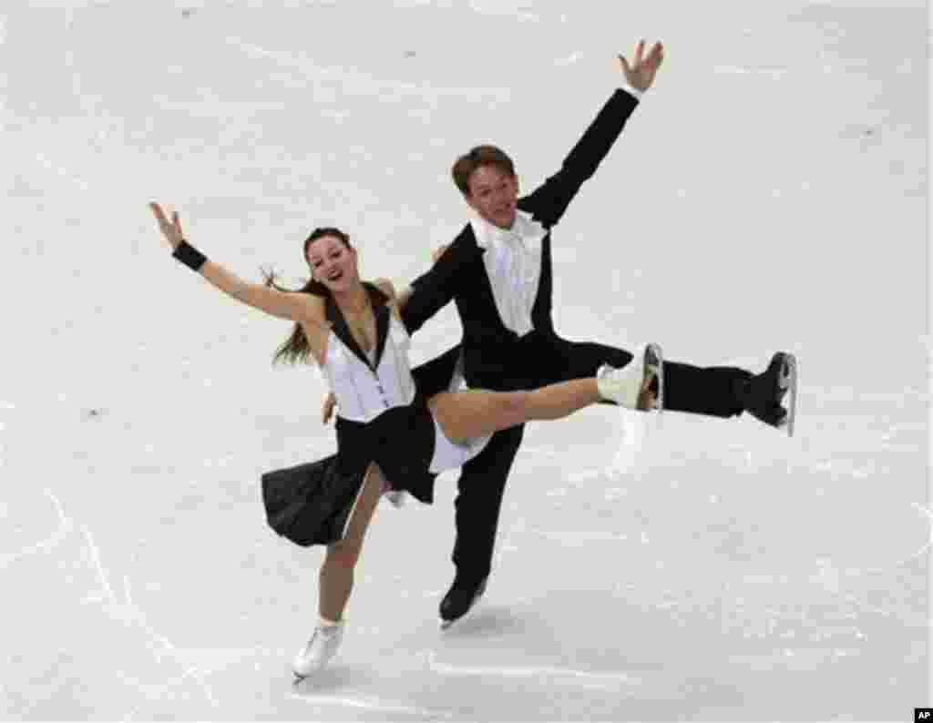 Tanja Kolbe and Stefano Caruso of Germany compete in the ice dance short dance figure skating competition at the Iceberg Skating Palace during the 2014 Winter Olympics, Sunday, Feb. 16, 2014, in Sochi, Russia. (AP Photo/Ivan Sekretarev)